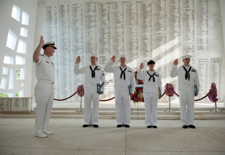 PEARL HARBOR (June 9, 2011) Quartermaster 1st Class Reed T. Gonzales, left, Aviation Ordnanceman 3rd Class John C. Anthony, Information Systems Technician 2nd Class Sarah M. Peachey, and Aviation Machinist's Mate 1st Class Jason C. Evans, all assigned to the Nimitz-class aircraft carrier USS Carl Vinson (CVN 70), reenlist with Carl Vinson Commanding Officer Capt. Bruce H. Lindsey at the USS Arizona Memorial at Joint Base Pearl Harbor-Hickam. Carl Vinson and Carrier Air Wing (CVW) 17 recently completed a deployment to the U.S. 5th and U.S. 7th Fleet areas of responsibility. (U.S. Navy photo by Mass Communication Specialist 2nd Class James R. Evans/Released) 110609-N-DR144-300